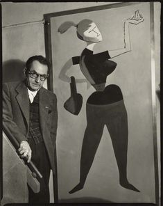 Man Ray with his painting 'Mademoiselle H,' 1954  by Ida Kar