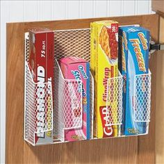 "YES PLEASE!  $10.98 Kitchen wrap organizer made of vinyl-covered wire meshing has 4 compartments for holding wax paper, aluminum foil, plastic wrap, sandwich bags, and other wraps. Mounts on wall or an inside cabinet to keep all your wraps out of sight, but still in reach. Great organizational  piece for the kitchen! Minor installation required, hardware included.13 1/2"" x 11 1/2"" x 3 1/2"" H."