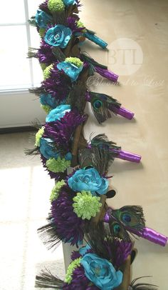 Peacock feather bouquets all lined up and ready to go. Stunning! WV, VA, MD, DC Wedding | Wedding Planning | Peacock Feather bouquet | Peacock Wedding | Wedding Bouquet| Bloomed To Last | Peacock Bridal Bouquet