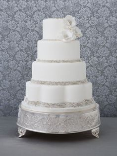 Bobbette & Belle Silver Sugar Pearl wedding cake. The silver sugar pearls around each tier sparkle like diamonds in any venue. The handmade sugar flowers     are reminiscent of a vintage corsage