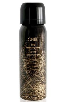 """""""This stuff smells like a hot man in a can. It's amazing and leaves no powdery residue, so your hair's not dull.""""    Oribe dry texturizing spray (travel size), $19.50"""