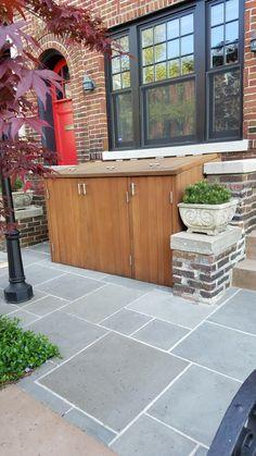 Reasonably nice garbage can solution, and nice smooth slate tile