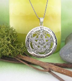 FREE Shipping Both Ways! The pentagram, moon, and earth are intricately woven together and make for a highly decorative piece for nature worshipers.