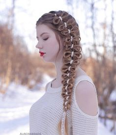 Interest braid decorated with bruises. Maybe you'll need for this hairstyle the help of friend or hairdresser.