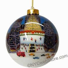 Rockefeller Center Christmas Ornaments Finely detailed hand painted ball ball Rockefeller Center Christmas ornament featuring the Rockefeller Center Tree, Skating Rink, the Prometheus statue and 5th Avenue. (http://www.nycwebstore.com/rockefeller-center-glass-ball-ornament/)