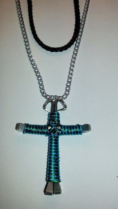 Green and turquoise candy cane wire wrapped horseshoe nail cross necklace jewelry