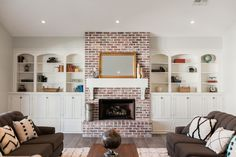 Brick fireplace with custom book shelves - by Rafterhouse.