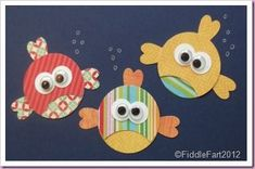 I really think these fish are just too cute and would look great on a scrapbook page :) Card: fish - punch art