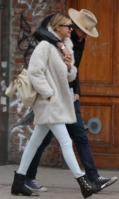 Click to see best white fuzzy mid length coats for under $200 like Gigi Hadid wears: http://www.slant.co/topics/4405/~white-faux-fur-fuzzy-mid-length-coats-for-under-200 model street style winter