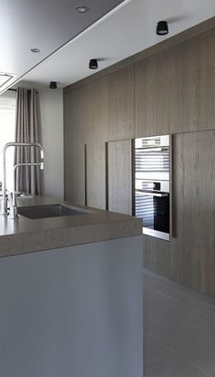 Floor to ceiling cupboards and concrete worktop