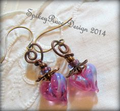 Handcrafted lampwork hearts with copper wirework.