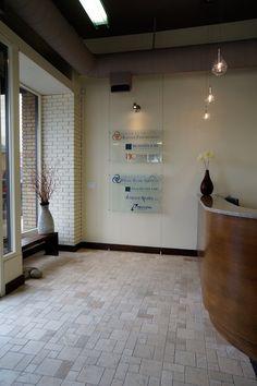 Modern, open office design by Hatch Interior Design, Kelowna, BC. Custom glass signage in distance.