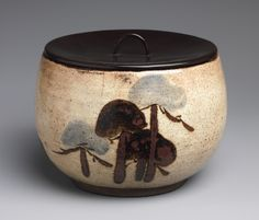 Water jar (mizusashi) with design of pine trees, Edo period (1615–1868), ca. 1720  Japan  Stoneware with underglaze iron-oxide and lacquer cover (Kenzan style)