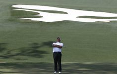 U.S. golfer Fred Couples stretches his back on the 10th green during the second round of the Masters golf tournament at the Augusta National Golf Club in Augusta, Georgia April 11, 2014. REUTERS/Mike Segar