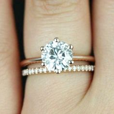 Pin for Later: 34 Creative Ways to Style Your Wedding Band Choose Tiny Diamonds to Play Up Your Bigger One