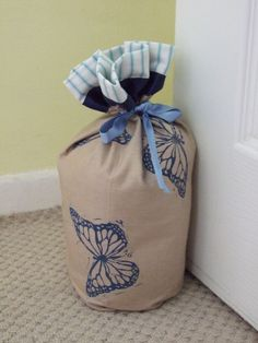 This doorstop has been hand printed with blue butterflies on linen. It has been lined with blue and white stripe cotton for extra strength and overlapped at the top so that a little shows on the outside. Doorstop, Blue Butterfly, Blue And White, Hands, Printed, Prints