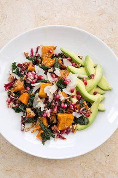 Overnight Avocado Kale Salad with Roasted Sweet Potatoes and Pomegranate Vinaigrette.