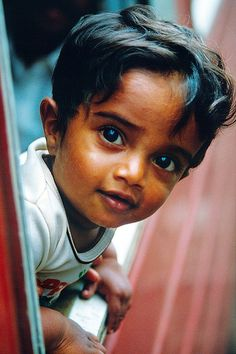 Curious boy on the train from Kandy to Colombo, Sri Lanka by tschnitzlein, via Flickr