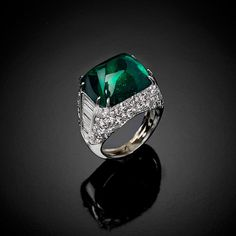 "A ""Sugar Loaf"" emerald cut and diamonds ring MONTECARLO"