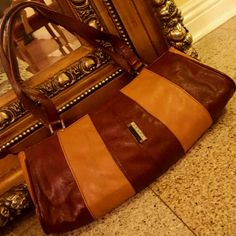 PRADA RARE  LEATHER BAG IN GREAT CONDTION Great details used and in great condition one of a kind sz medium Prada Bags