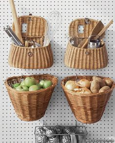 Baskets designed to hold fishing tackle or to hook onto a bicycle's handlebars come ready-made with holes in the back. Hung on a kitchen wall with cup hooks, or on a Peg-Board, they make great receptacles for unwieldy kitchen tools or fruits and vegetables that don't require refrigeration.