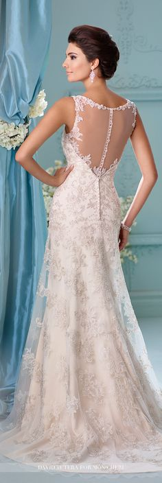 David Tutera for Mon Cheri - 216237 Kaltrina - Sleeveless tulle over crepe soft satin and metallic hand-beaded embroidered lace fit and flare gown with beaded illusion shoulder straps, soft V-neckline trimmed with beading and illusion, illusion back with beaded lace and crystal button closures, chapel length train.Sizes: 0 - 20Colors: Ivory/Light Gold, Ivory White
