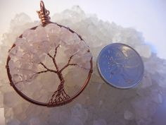 Pink Quartz Tree of Life Pendant ~ Gemstone Necklace  This simple yet beautiful Tree of Life is made with antique copper wire for the trunk and branches and genuine Pink Quartz gemstones for the leaves. The hoop measures just under 1 1/2 across and will come on a 16 copper chain. If you need a longer chain, just leave a comment when you place your order and I will be happy to accommodate! If you would like a custom tree made, please send me a message, I would love to create something jus...