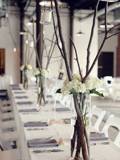 Long-Rustic-Centerpieces-branches For tall white planters with greenery cascading over the edges?