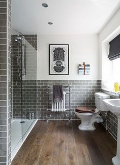 Grey metro tiled bathroom with a classic yet modern feel.