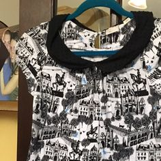 Anthropologie Printed Top Super cute and perfect for spring this top from anthropology is in great, pre-loved condition and ready for a new home. Size small, will fit an XS-S comfortably. Colors are Black, white and a little bit of blue. Priced to sell! Anthropologie Tops