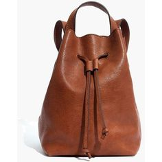 MADEWELL The Somerset Mini Backpack ($148) ❤ liked on Polyvore featuring bags, backpacks, english saddle, madewell, mini drawstring backpack, brown leather rucksack, drawstring backpack bag and draw string backpack