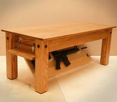 Are you looking for a secret space to hide your weapons? Well, stop searching and look at this elegant Oak Coffee Table by NJ Concealment Furniture that comes with a secret compartment at the bottom to hide your secret stuff.