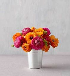 Ranunculus, orange & hot pink...cute for some of your tables. Could use a mason jar and place on top of tree bark