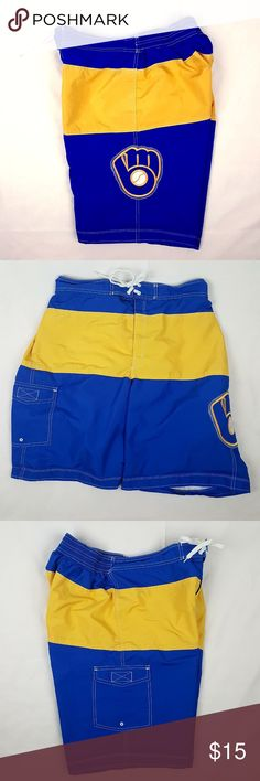 """Milwaukee Brewers Carl Banks Blue L Swim Trunks These colorful swim trunks/shorts are a great way to nod towards the Wisconsin Brewers while spending a day at the waterpark.  In good used condition. No rips, tears, stains or holes. Washed and clean. The care tag has faded a bit but is still legible.  Brand Name: Cooperstown Collection Color: Yellow & Blue Size: Large  Measurements Waist: 15 1/2"""" (doubled 31"""") Front Rise: 13"""" Back Rise: 17"""" Inseam: 9 1/2"""" Length: 21"""" Leg Opening: 13"""" (doubled…"""