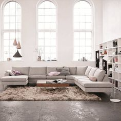 A large corner sofa creates a room within a room in an open-plan space.