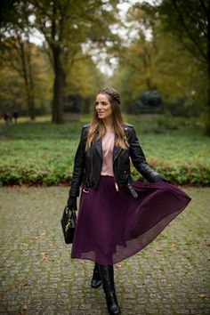 Don a pleated skirt in a rich fall hue with a moto jacket for a romantic look with an edgy vibe.