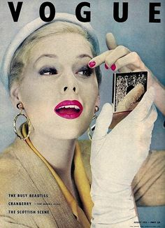 The all important last minute compact check. Vogue 1950s
