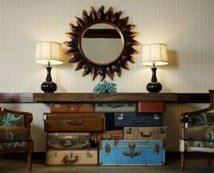 A grouping of old suitcases make up the base of this table. The grouping of sizes and colors makes this a beautiful focal point.