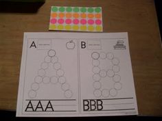 ABC dot worksheets. Can use them with round stickers (as pictured), but also with dot-paints. Could also laminate these and have kids roll up playdough, place them in the circles and pound them with a playdough hammer. Could be fun!