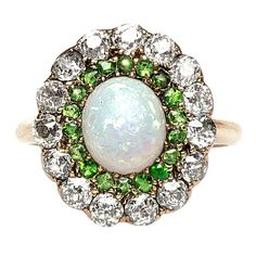 Opal, Diamond & Demantoid Gold Victorian Ring   From a unique collection of vintage engagement rings at http://www.1stdibs.com/jewelry/rings/engagement-rings/
