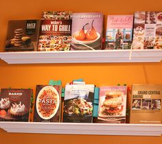 storing cookbooks like they're displayed in a bookstore--i love this idea! i spent years working in bookstores when i was in grad school, and i have an affinity for nicely organized and displayed books. and i don't have so many cookbooks that this would be difficult. love!