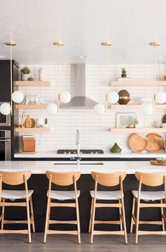 Kitchen Interior Design Check out this amazing, modern kitchen reno with midcentury lights by Vintage Revivals Floating Shelves Kitchen, Kitchen Shelves, Kitchen Cabinets, Kitchen Island, Kitchen Countertops, Kitchen Sink, Modern Kitchen Design, Interior Design Kitchen, Kitchen Designs