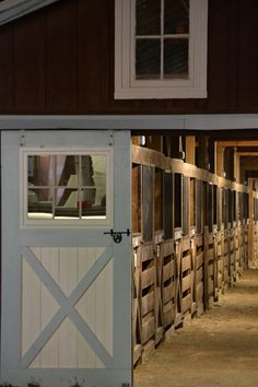 Not a fan of the stalls, but I want doors like these on the front of my barn someday