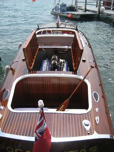 """if God wanted there to be fiberglass boats, he would have planted fiberglass trees.""  i want a woodie sooo baddddd"