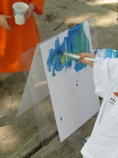 Make an easel by taping two pieces of plexiglass together.  Fold it up and put it away for easy storage!