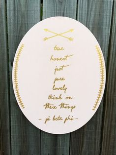 This sweet canvas is hand painted in light pink and gold acrylic, featuring arrows and scripted wording. It reads, True, Honest, Just, Pure, Lovely.