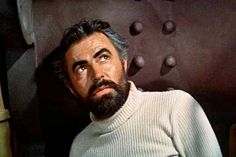Captain Nemo from 20,000 Leagues under the Sea.  He counts as Phantomy because:  He's crazy/sexy/cool, plays organ like a boss, and has a groovy gothic lair....under da sea!