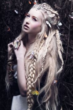 Amazing long white blonde hair with braids, dreadlocks and butterflies