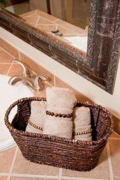 washcloths in basket wrapped in elastic bracelets