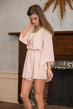 """""""Sassy And Flashy Romper, Taupe""""    This romper is sassy, flashy and so much more! It's flowing material is heavenly and graceful! What's really got us loving this romper though is the crochet back!! It's gorgeous!"""